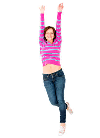 excitement: Happy casual girl jumping - isolated over a white background