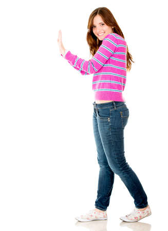 Woman pushing an imaginary object - isolated over a white background  photo