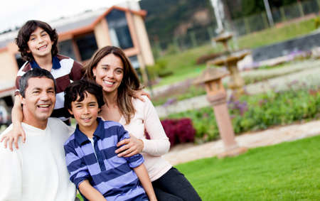 Portrait of a beautiful family looking very happy and smiling  Stock Photo - 14095163