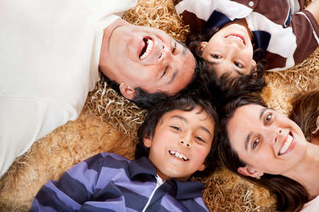 head home: Happy family portrait laying on the carpet at home