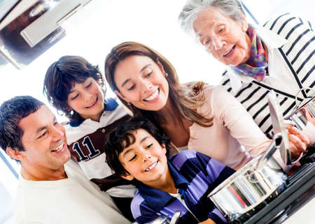 Happy family cooking together at home and smiling photo
