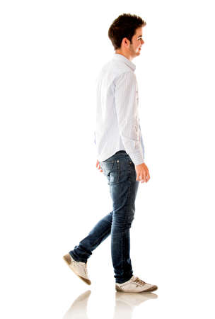 walking: Casual man walking - isolated over a white background  Stock Photo
