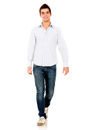 Casual young man walking - isolated over a white background  Stock Photo - 14095144