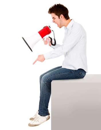 dictatorial: L'uomo urla con un megafono - isolato su uno sfondo bianco Archivio Fotografico
