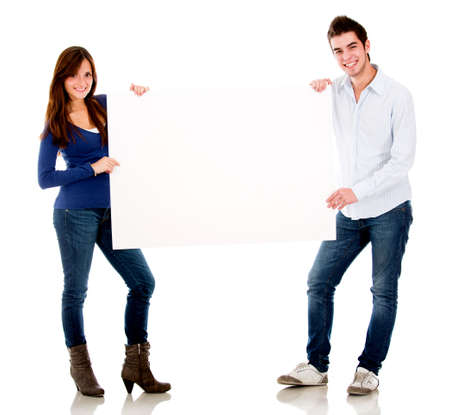 Couple holding a banner - isolated over a white background  photo