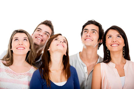 looking over: Group of young friends looking up - isolated over white  Stock Photo