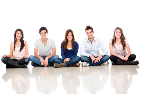 girl bonding: Group of young people sitting on the floor - isolated over white