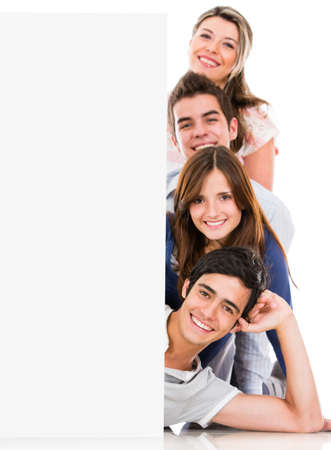 Happy group of people with a banner - isolated over a white background  photo