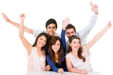 personas festejando: Grupo de personas que celebraban con los brazos arriba - aislados en un blanco Backgorund