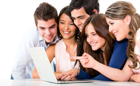 browsing: Group of friends with a laptop computer - isolated over white backgorund  Stock Photo