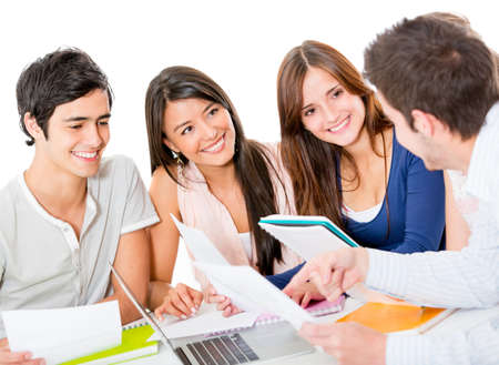 Group of young people studying together - isolated over a white background  photo