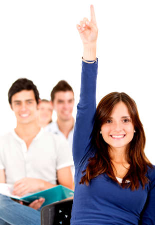 raising hand: Female student in class raising hand - isolated over a white background