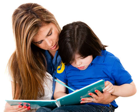 Boy coloring a book with his mother - isolated over white background  photo