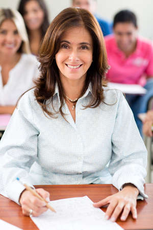 Happy female teacher in a classroom at the university  photo