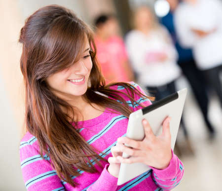Woman holding a tablet computer and smiling photo