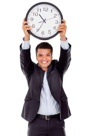 timekeeping: Businessman holding a clock - isolated over a white background  Stock Photo