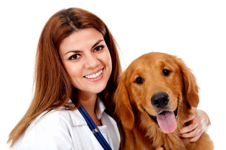Female vet with a beautiful dog - isolated over a white background photo