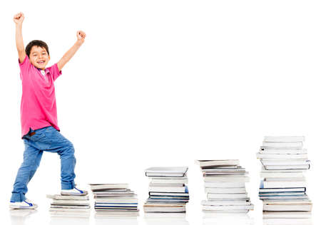 Happy boy climbing in his education - isolated over a white background  photo
