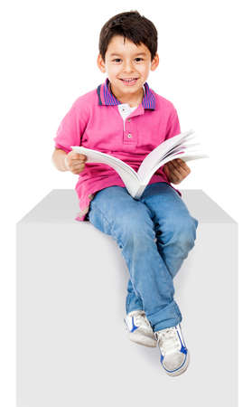 child book: Happy kid reading a book and smiling - isolated over white background