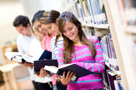 student reading: Group of people reading books at the library  Stock Photo