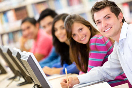 com: Online education - group of students studying with computers