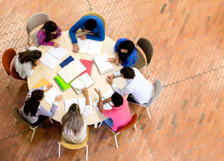 table of contents: Study group with young people sitting in a round table
