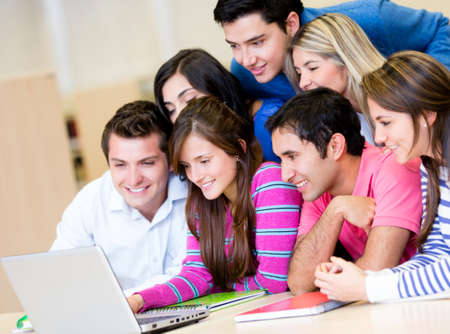 Group of people studying with a laptop computer  Stock Photo - 14231686