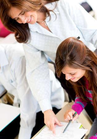 explaining: Teacher explaining something to a female student in class
