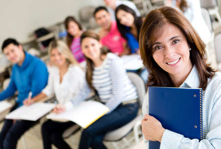 university professor: Older female student in class holding a notebook  Stock Photo