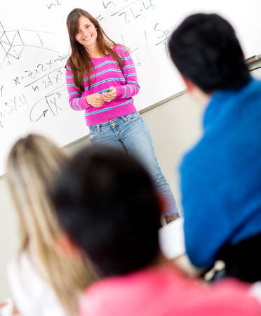 Female student standing in front of a class  Stock Photo - 14231672