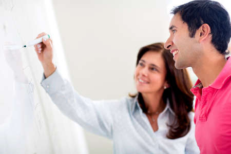 clarifying: Teacher helping a student solve his doubts about the subject