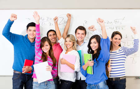 Happy group of students celebrating with arms up  photo