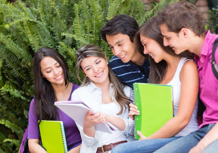 Group of friends studying together and smiling  photo