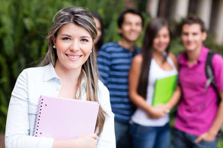 latin students: Beautiful young woman with a group of uni students  Stock Photo