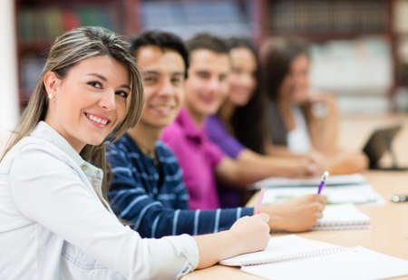 adult class: Group of students in class taking notes  Stock Photo