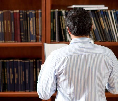 Man at the library looking for a book photo