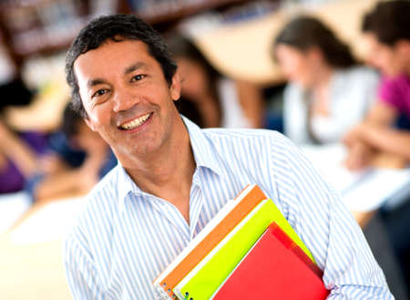 students fun: Older male student at the university smiling