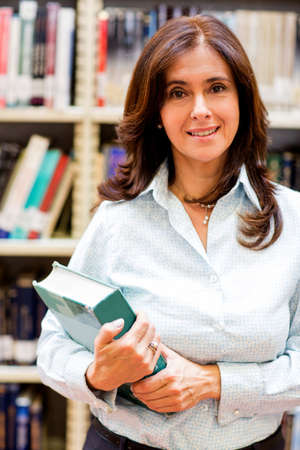Woman at the library holding a book  photo