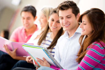 Group of friends studying together and smiling  Stock Photo - 14317986