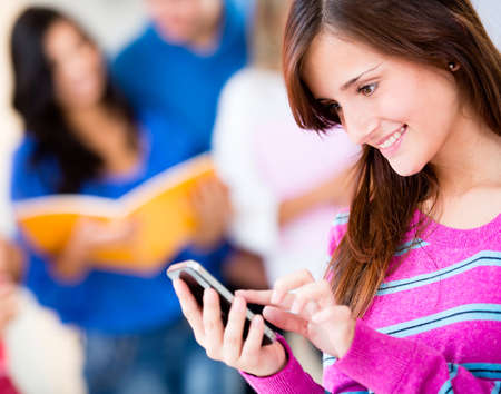 mobile sms: Woman texting on her cell phone and smiling
