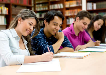 study: Group of college students studying at the library Stock Photo