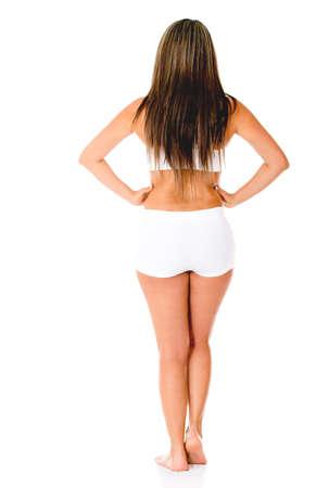 wit ondergoed: Achteraanzicht van een mooie vrouw in wit ondergoed - geïsoleerd