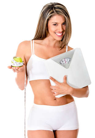 Woman on a diet holding a scale - isolated over a white background  photo