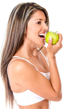Beautiful woman biting an apple - isolated over a white background  photo
