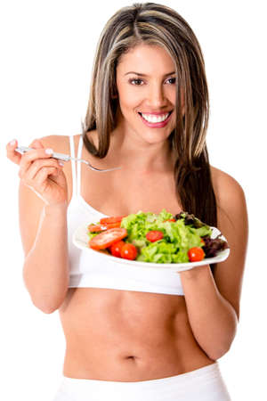 Healthy eating woman holding a salad and smiling - isolated over white  photo