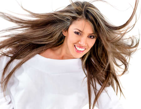 Woman with gorgeous long hair against the wind - isolated over white  photo