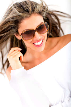Fashion woman portrait wearing sunglasses - isolated over a white background  photo