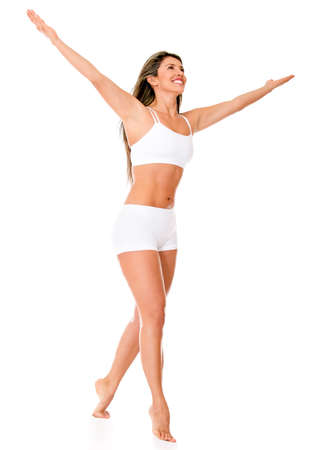 Confident woman walking in her underwear - isolated over a white background  photo