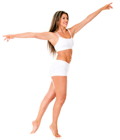 moves: Female ballet dancer practicing her moves - isolated over a white background  Stock Photo