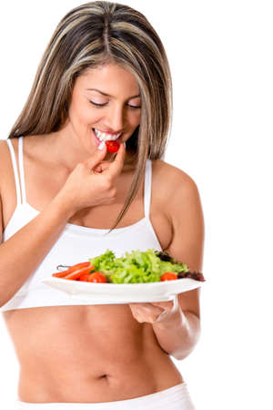 Female vegetarian enjoying a salad - isolated over a white background  photo